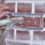 Mortar joint completely cut around the brick. Brick's removal is easy.