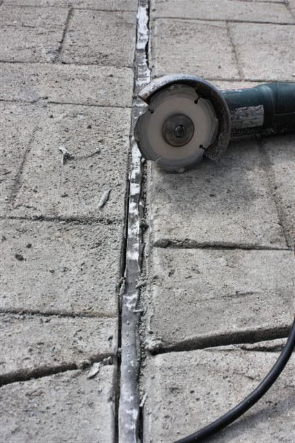 Joint sealant - Sliced away from concrete.