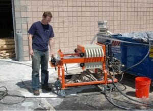 Mudhen 1.0 on the job . . . Extracting slurry from a 20 yard dumpster.